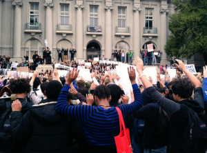 Google Image: Berkeley High students in a moment of a silence at City Hall, 12/2014